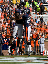 Virginia wide receiver Maurice Covington (80) celebrates with Virginia wide receiver Cary Koch (26) after scoring a touchdown.  The #23 Virginia Cavaliers defeated the #24 Wake Forest Demon Deacons 17-16 at Scott Stadium in Charlottesville, VA on November 3, 2007.