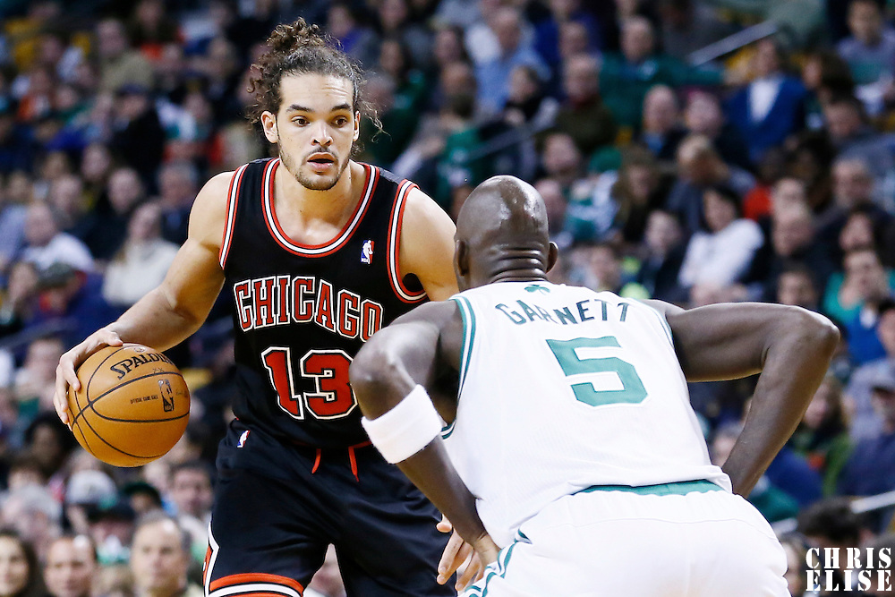 18 January 2013: Chicago Bulls center Joakim Noah (13) dribbles during the Chicago Bulls 100-99 overtime victory over the Boston Celtics at the TD Garden, Boston, Massachusetts, USA.