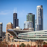 Photo of Chicago skyline with Soldier Field and Sears Tower (Willis Tower). Soldier Field is a football stadium and home to the Chicago Bears NFL football team. Sears Tower is one of the tallest buildings in the world. Picture was taken in late 2011 and is high resolution.