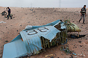 The wreckage of a government MIG fighter jet lies strewn across Libyan the desert outside the Libyan coastal oil town of Ras Lanouf, Libya March 05, 2011. Rebel forces shot down the fighter with anti-aircraft guns during their offensive toward Sert, killing the two pilots inside. .
