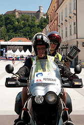 Photographer Matic Klansek Velej during chronometer (17,8km) of Tour de Slovenie 2012, on June 17 2012, in Ljubljana, Slovenia. (Photo by Urban Urbanc / Sportida.com)