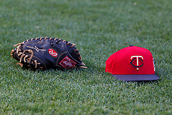 SAN FRANCISCO, CA - MAY 23:  General view of a Minnesota Twins baseball hat and a glove on the field during batting practice before the game against the San Francisco Giants at AT&T Park on May 23, 2014 in San Francisco, California.  The San Francisco Giants defeated the Minnesota Twins 6-2.  (Photo by Jason O. Watson/Getty Images) *** Local Caption ***