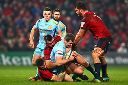 Ian Whitten of Exeter Chiefs is brought to ground by Peter O'Mahony and Niall Scannell of Munster Rugby - Mandatory by-line: Ken Sutton/JMP - 19/01/2019 - RUGBY - Thomond Park - Limerick,  - Munster Rugby v Exeter Chiefs -