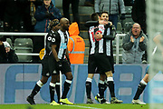 Federico Fernandez (#18) of Newcastle United celebrates Newcastle United's second goal (2-1) with Fabian Schar (#5) of Newcastle United during the Premier League match between Newcastle United and Southampton at St. James's Park, Newcastle, England on 8 December 2019.
