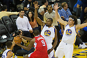 Golden State Warriors forward Kevin Durant (35) defends Los Angeles Clippers forward Alan Anderson (9) under the basket during a NBA preseason game at Oracle Arena in Oakland, Calif., on October 4, 2016. (Stan Olszewski/Special to S.F. Examiner)