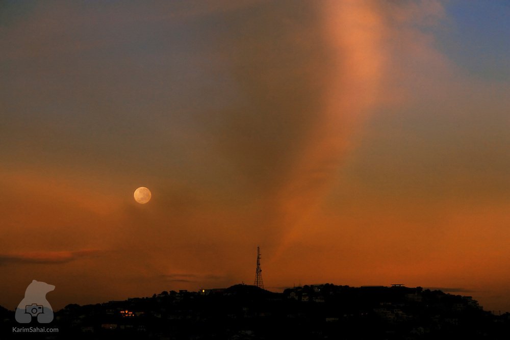 Full moon rising over Mt Victoria, Wellington, New Zealand.