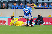AFC Wimbledon defender Jon Meades (3) tackles Rochdale FC midfielder Andy Cannon (27) during the EFL Sky Bet League 1 match between Rochdale and AFC Wimbledon at Spotland, Rochdale, England on 27 August 2016. Photo by Stuart Butcher.