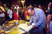 19 SEPTEMBER 2011 - NEW YORK, NY: Rudy Giuliani, mayor of New York, signs a condolences book for firefighters at the firehouse for Battalion 9, Ladder 4, Engine 54 on 8th Ave at 49th Street in Manhattan, Sept. 18, 2001. Fifteen firefighters from the station were killed in the terrorist attack on the World Trade Center Towers that took place on Sept. 11, 2001. More than 2,900 people, including hundreds of New York firefighters, were killed when terrorists crashed two airliners into the towers. .PHOTO BY JACK KURTZ