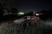 Car wrecks sit rotting away in Bangkok's 'car cemetery'. <br /> <br /> According to a 2014 study by the University of Michigan&rsquo;s Transportation Research Institute Thailand ranks number 2 in the world for road fatalities, narrowly second only to Namibia. The report found a frightening 44 road deaths were recorded per 10,000 population. The high accident rate is often attributed to reckless driving, including driving while intoxicated, and lack of safety precautions such as wearing a helmet on motorbikes. A WHO report indicated that 26 percent of road deaths in Thailand involve alcohol.<br /> <br /> The sheer number of crashed vehicles is so high that police now hold auctions to sell off the vehicles, either not wanted by their owner or beyond repair, and it has become a good business. But the auctions are a relatively new phenomenon where previously cars would be kept at police stations until the legal case is complete and then deposited at a collection site.<br /> <br /> On the outskirts of Bangkok in a scruffy suburb is one such depository. Dubbed &lsquo;the car cemetery&rsquo; by locals it was where many of Bangkok&rsquo;s damaged wrecks would end up if no-one else wanted to them. But the site has also taken on another reputation; that of being one of the most haunted places in the city, third to be precise according to a local TV station. Thai&rsquo;s are very superstitious people and most believe in ghosts or spirits. Here it was believed that the spirits of those killed in the crashes remained with the vehicles they died in. Many a passerby or taxi driver have stories of people in and around the compound who then simply vanishing. Locals became so frightened of the place that a group of Thai Buddhist monks from a nearby temple were invited in to perform a ritual exorcism to release the spirits.<br /> <br /> With most crashed cars now being bought at the auctions the car cemetery doesn&rsquo;t receive new vehicles anymore but many of the old ones remain su