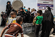 Women and children flee for refuge as the battle gets intense in West Mosul, Iraq.<br />