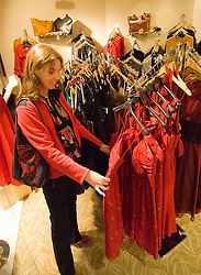 Washington DC; USA: The Georgetown area, known for its shopping and historic brick homes.  Shopping venue known as Shops at Georgetown Park.  Woman looking at dresses in shop Moda Nova.  Model released..Photo copyright Lee Foster Photo # 20-washdc75597