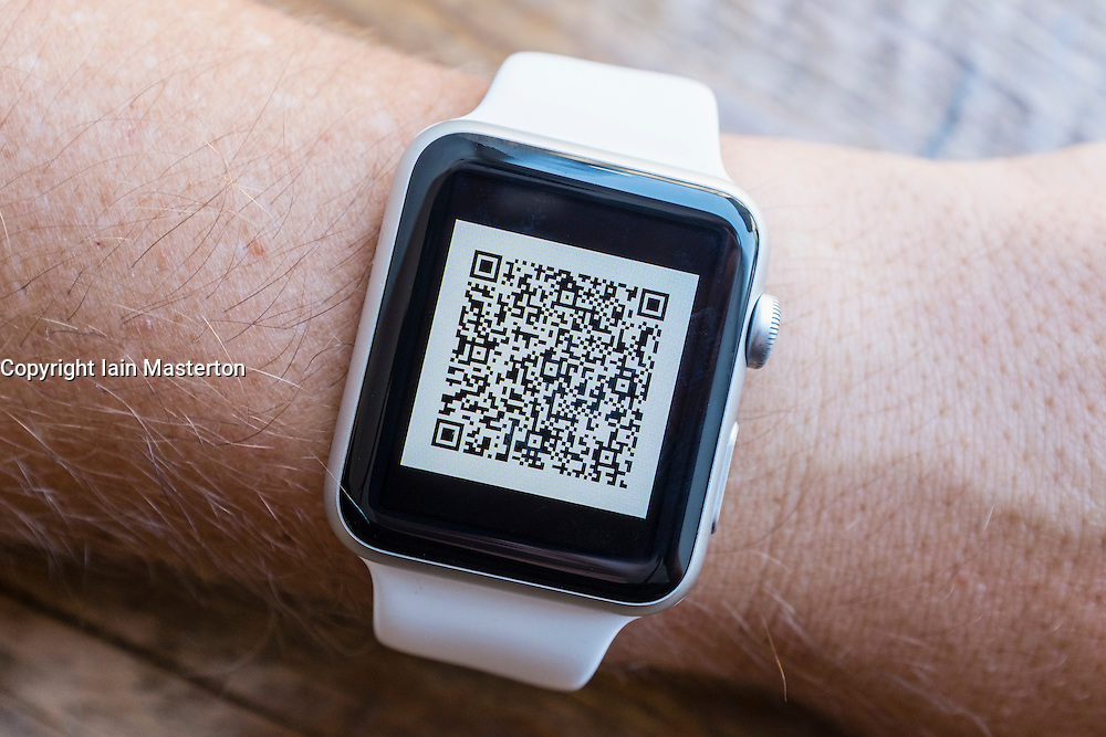 Airline passenger boarding pass barcode on an Apple Watch