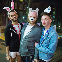 © Licensed to London News Pictures . Manchester , UK . 05/04/2015 . Three men wearing seasonal rabbit ears , on Canal Street , in Manchester's Gay Village . Revellers on a Saturday night out during the Easter Bank Holiday weekend . Photo credit : Joel Goodman/LNP