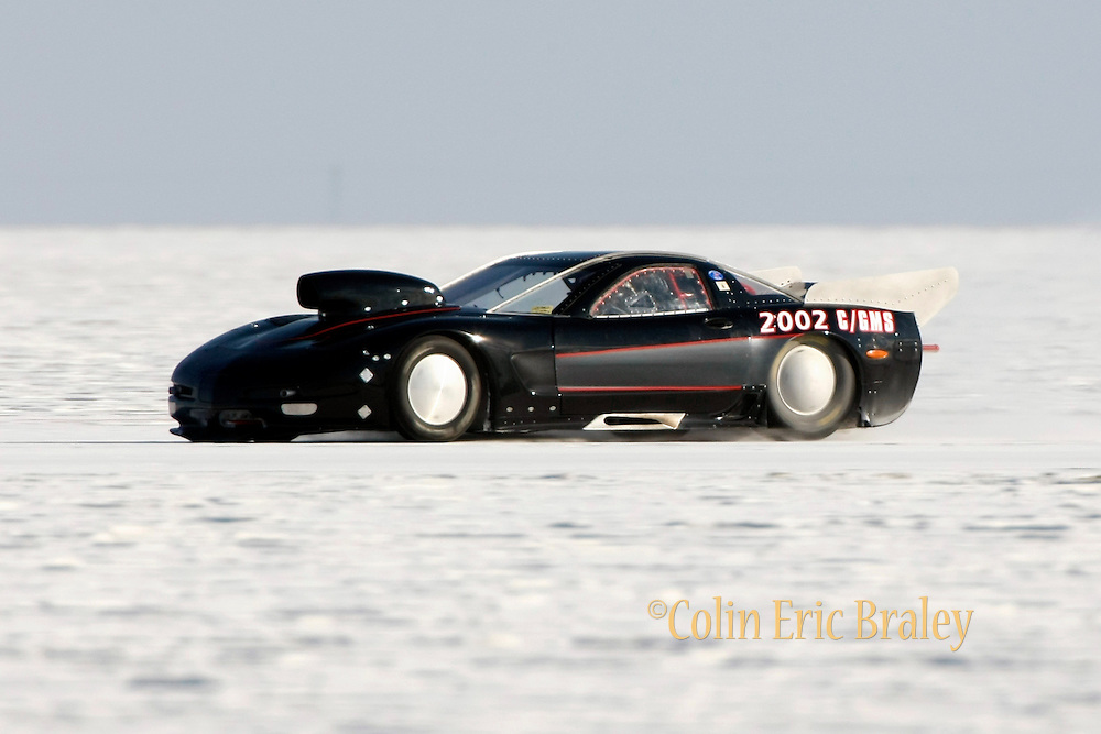 "Best cars-people-atmosphere-photos of 2009 Bonneville Speed Week-  Roland ""Sandy"" Percey, owner and driver of the 2002 Chevy Corvette, from Altadena, CA. makes a run at the Bonneville Speed Way. August 9, 2009.  Photo by Colin E. Braley"