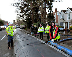 A section of an 'Aqua Dam' is deployed in Chertsey Bridge Road, Surrey, which it is hoped will protect parts of Chertsey from flooding, United Kingdom, Thursday 13th February 2014. Picture by David Dyson / i-Images