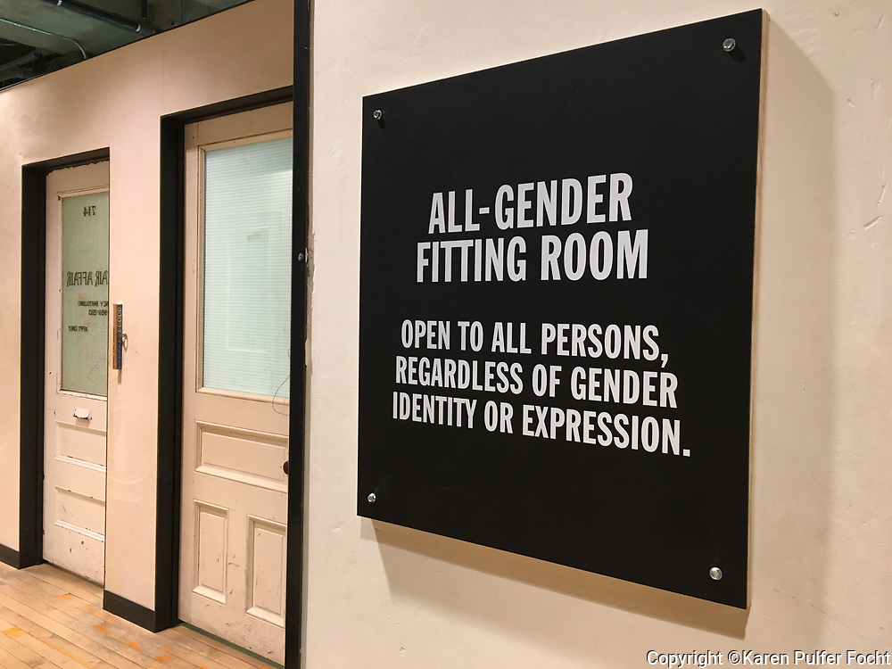 "A Manhattan shop has All-Gender Fitting Rooms. The All-Gender Fitting Rooms are ""open to all persons, regardless of identity or expression."""