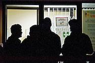 Roma, 13 Nov 2014<br /> Terzo giorno di tensioni tra italiani ed immigrati ospiti nel centro di accoglienza per rifugiati nel quartiere di Tor Sapienza. La polizia in tenuta antisommossa davanti all'ingresso  del centro di accoglienza  a protezione dei migranti<br /> Rome, Italy. 13th November 2014<br /> Third day of tensions between Italian  and immigrants guests in the migrant reception center in the neighborhood of Tor Sapienza. Police in riot gear outside the entrance of the  reception center  to the protection of migrants.