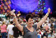 A fan celebrates taking a photo of friends or family as the Steve Miller Band performs behind her at the Fraze Pavilion in Kettering, Thursday, June 23, 2011.