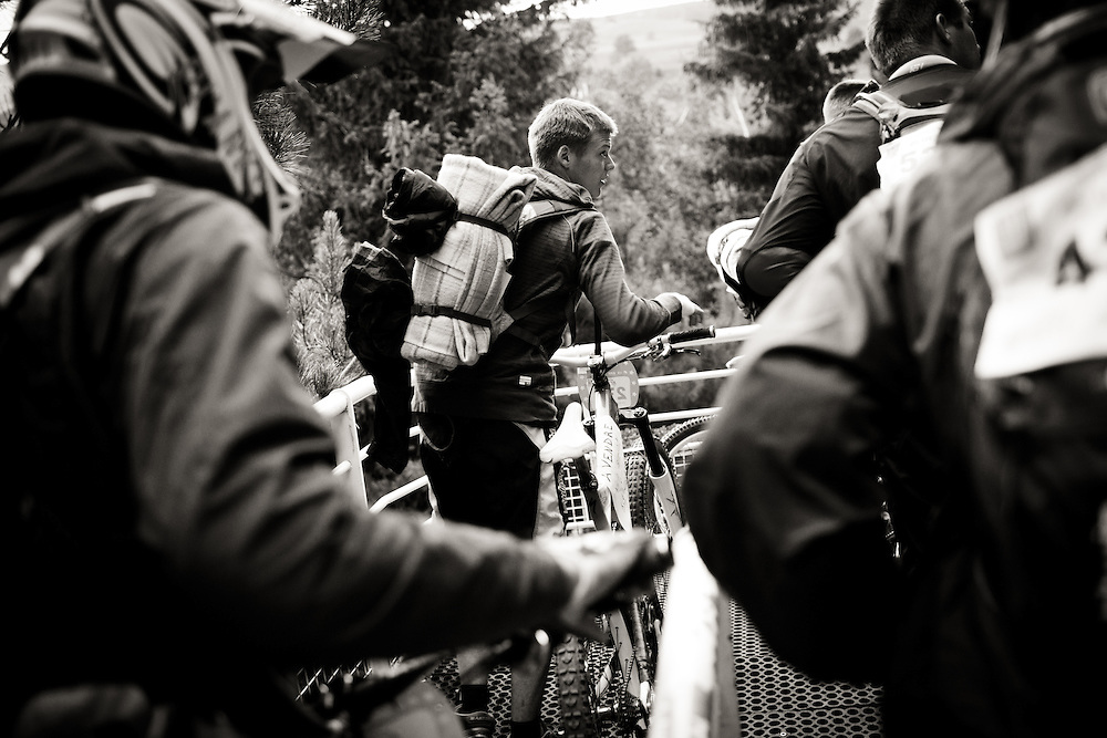 Riders load their bikes into gondolas to head up the mountain. Mountain of Hell race, Les Deux Alpes, France.