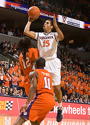 Virginia guard Sylven Landesberg (15) shoots over Clemson forward/center Raymond Sykes (12).  The Virginia Cavaliers defeated the #12 ranked Clemson Tigers in overtime 85-81 at the John Paul Jones Arena on the Grounds of the University of Virginia in Charlottesville, VA on February 15, 2009.