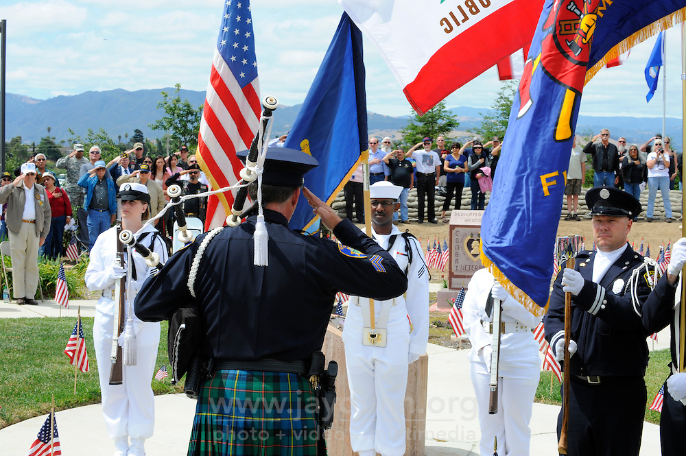 The bag piper salutes assembled color guards at Monday's somber Memorial Day remembrances at the Monterey County Vietnam Veterans Memorial in Salinas.