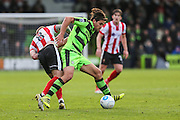 Forest Green Rovers Darren Carter(12) tangles with Lincoln City's Alan Power during the Vanarama National League match between Forest Green Rovers and Lincoln City at the New Lawn, Forest Green, United Kingdom on 19 November 2016. Photo by Shane Healey.