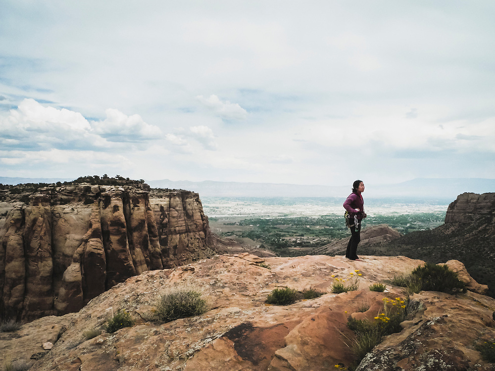 Shiho Kobayashi enjoys the view from the summit of Independence Monument, Colorado National Monument.