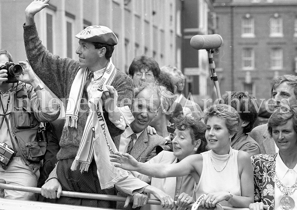 Tour de France winner Stephen Roche sports the Dublin colours as he and his wife Lydia tour Dublin City Centre on an open-top bus, while on his way to the Civic Reception held in his honour at the Mansion House, Dublin, 26/07/1987 (Part of the Independent Newspapers Ireland/NLI Collection).