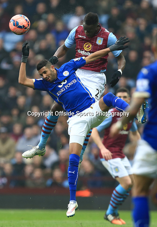 15th February 2015 - FA Cup 5th Round - Aston Villa v Leicester City - Aly Cissokho of Aston Villa battles for a header with Tom Lawrence of Leicester City - Photo: Paul Roberts / Offside.