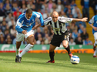 Photo: Leigh Quinnell.<br /> Birmingham City v Newcastle United. The Barclays Premiership. 29/04/2006.Newcastles Stephen Carr pushes Birminghams Julian Gray to one side.