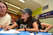 "Volunteers from Keep Tucson Together and attorney Margo Cowan provide legal assistance to persons effected by changes to DACA, or Deferred Action Childhood Arrival, which provided legal protection to those brought into the United States illegally as children, at a clinic at Pueblo Magnet High School, Tucson, Arizona, USA.  ""Edna"", 21, entered the USA on a legal visa at the age of 9, along with her family.  Her father intended to sat in the USA to work. Her family chose to overstay their visas to avoid prolonged separation from her father.  She applied for and was granted DACA status, which lapsed in August, 2017.  With changes to DACA, she faces possible deportation if stopped by law enforcement.  She is a nursing student under the protection of DACA, but may lose that right, as she lost her job when she lost her DACA status.  She is now unemployed.  She initially arrived in the USA with her parents and two siblings.  Her parents then had two US born children.  She attends the clinic to be prepared with legal advice should she be stopped by law enforcement and be slated for deportation to Mexico. Volunteer, Sally Rusk, left, provides asistance."