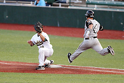 07 June 2013:   Mike Schwartz gets the put out throw ahead of hitter Tyler Stubblefield  during a Frontier League Baseball game between the Southern Illinois Miners and the Normal CornBelters at Corn Crib Stadium on the campus of Heartland Community College in Normal Illinois