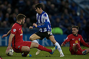 Kieran Lee (Sheffield Wednesday) cuts inside the Blackburn defender to get a shot in on goal during the Sky Bet Championship match between Sheffield Wednesday and Blackburn Rovers at Hillsborough, Sheffield, England on 5 April 2016. Photo by Mark P Doherty.