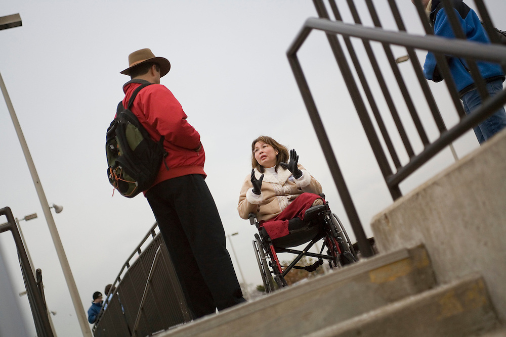 Then candidate for the US Congress, Tammy Duckworth, campaigns at a Metra train station in Lombard, a suburb of Chicago. Duckworth lost her legs and seriously injured her right arm when her Black Hawk helicopter was shot down while she was serving in Iraq.