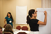 Fabiola Carrion, of the Progressive States Network, takes notes for the Rural Broadband Policy Group meets before the start of the 2011 Gathering of the National Rural Assembly in St. Paul, MN, on June 27, 2011.