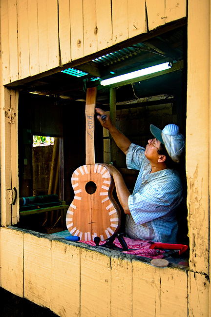 Guitar maker crafts a guitar at Guitarros Zepeda, a guitar<br />