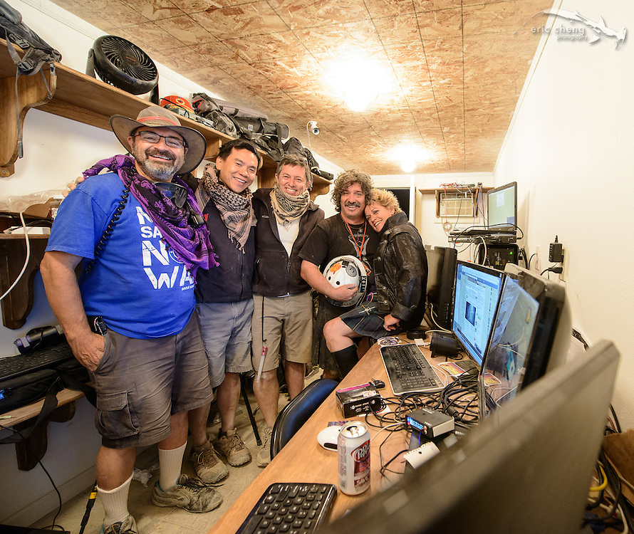 The aerial streaming crew (George Krieger, Eric Cheng, Gerard Mattimoe) with The Man creator Andrew Johnstone and his new wife, Jeri Schneider Johnstone, in the streaming container. Burning Man 2014.