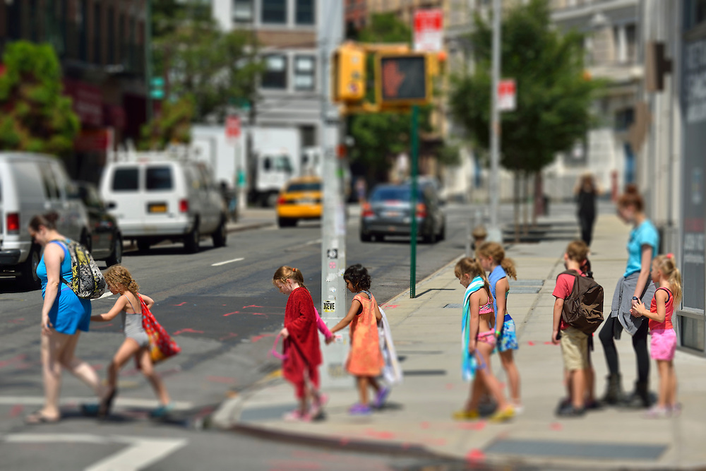Children crossing street on way to swimming pool, Soho, New York, USA