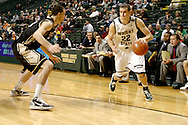 Raider sophomore Cole Darling (22) with the ball in the first half as the Idaho Vandals play the Wright State University Raiders at the Nutter Center, Tuesday, December 20, 2011.