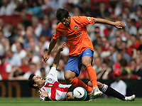 Photo: Lee Earle.<br /> Inter Milan v Valencia. The Emirates Cup. 28/07/2007.Inter's Julio Cruz(L) is tackled by Marco Caneira.