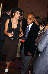 Artist TRACEY EMIN and her father ENVER EMIN at a party to celebrate the publication of Strangeland by artist Tracey Emin at 33 Portland Place, London W1 ON 21ST OCTOBER 2005.<br /><br />NON EXCLUSIVE - WORLD RIGHTS