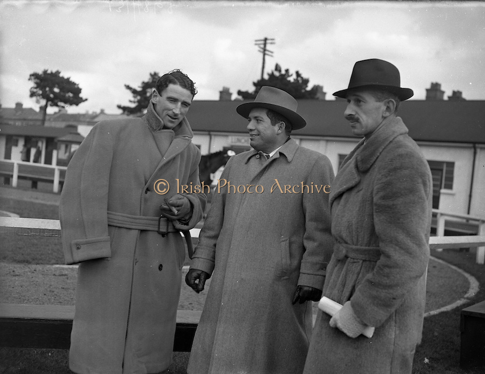 13/02/1953<br /> 02/13/1953<br /> 13 February 1953<br /> Aubrey Brabazon, well known jockey at the Annual New Years (horse) Sales at the R.D.S., Ballsbridge, Dublin. Centre is Mr. A. Grimaldo, Consul for Panama at Liverpool. right Captain K.P.G. Harboard.