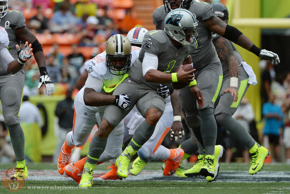 January 26, 2014; Honolulu, HI, USA; Team Rice defensive end Cameron Jordan of the New Orleans Saints (94) sacks Team Sanders quarterback Cam Newton of the Carolina Panthers (1) during the second quarter of the 2014 Pro Bowl at Aloha Stadium.