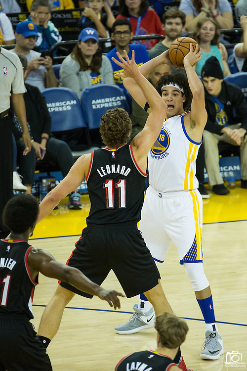 Golden State Warriors center Anderson Varejao (18) looks for an open teammate against the Portland Trail Blazers at Oracle Arena in Oakland, Calif., on October 21, 2016. (Stan Olszewski/Special to S.F. Examiner)