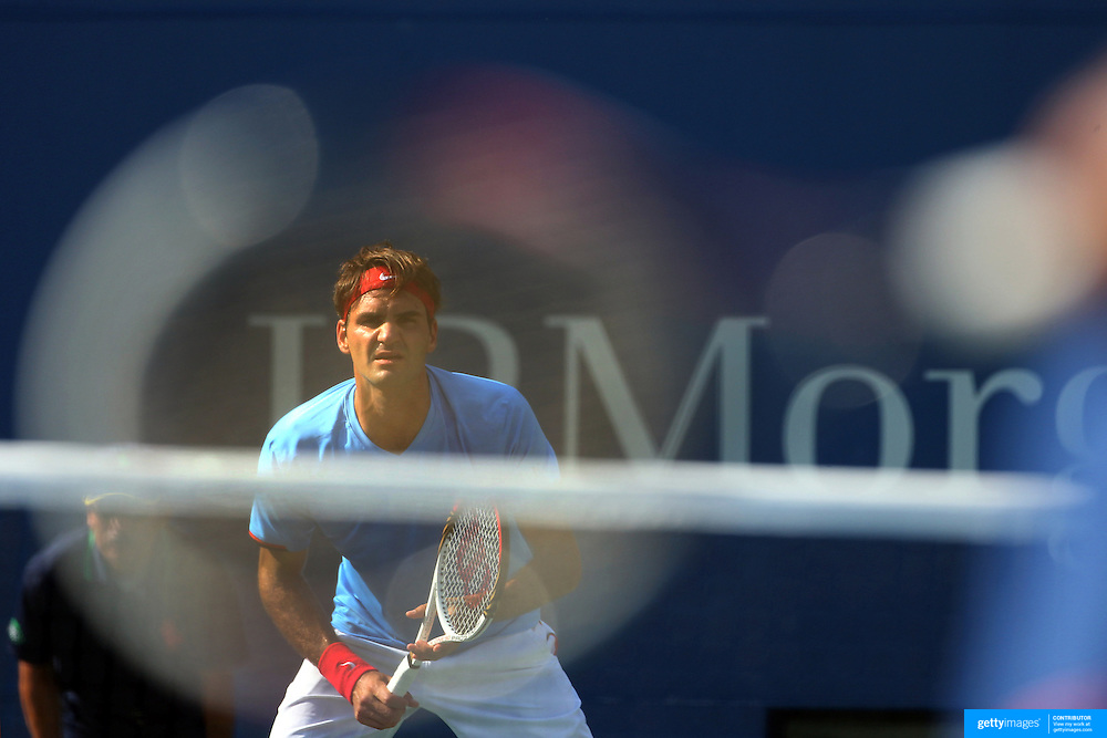Roger Federer, Switzerland, shot through the racquet of Fernando Verdasco, Spain, during the US Open Tennis Tournament, Flushing, New York. USA. 1st September 2012. Photo Tim Clayton