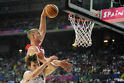 Mason Plumlee of USA vs Jaka Klobucar of Slovenia during basketball match between National Teams of Slovenia and USA in Quarterfinals of FIBA Basketball World Cup Spain 2014, on September 9, 2014 in Palau Sant Jordi, Barcelona, Spain. Photo by Tom Luksys  / Sportida.com <br /> ONLY FOR Slovenia, France
