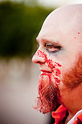 "Oct. 30, 2009 -- PHOENIX, AZ: CASEY WHITE, from Phoenix, participates in the ""Zombie Walk"" Friday night. About 200 people participated in the first ""Zombie Walk"" in Phoenix, AZ, Friday night. The Zombies walked through downtown Phoenix ""attacking"" willing victims and mixing with folks going to the theatre and downtown sports venues.  Photo by Jack Kurtz"