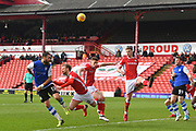 Sheffield Wednesday forward Atdhe Nuhiu (17)  heads towards goal against Barnsley FC midfielder Joe Williams (4), Barnsley FC defender Matt Mills (5) and Barnsley FC defender Liam Lindsay (6) during the EFL Sky Bet Championship match between Barnsley and Sheffield Wednesday at Oakwell, Barnsley, England on 10 February 2018. Picture by Ian Lyall.