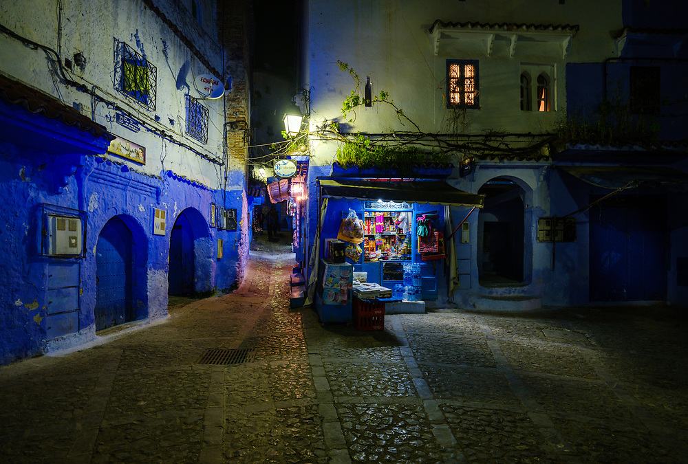 CHEFCHAOUEN, MOROCCO - CIRCA MAY 2018:  Street corner and shop in Chefchaouen at night.
