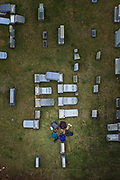 People gather in prayer amid the toppled headstones and damage at Mount Carmel Cemetery Monday February 27, 2017. ( DAVID SWANSON / Staff Photographer )